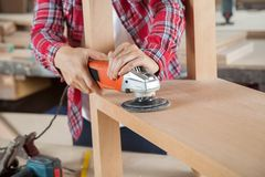 Carpenter Using Sander On Wood Royalty Free Stock Photos