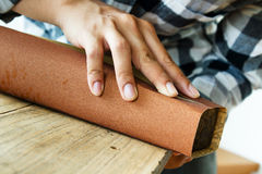 Carpenter using sandpaper stock photography