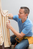 Carpenter Using Sandpaper On Bannister In Home. Carpenter Uses Sandpaper On Bannister In Home royalty free stock image
