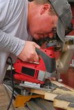 Carpenter using a saw Stock Photography