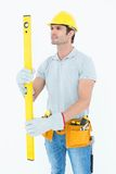 Carpenter using spirit level Stock Photography