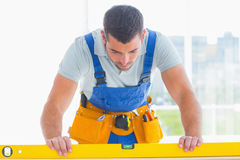 Carpenter using spirit level in office Stock Image