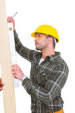 Carpenter using spirit level on wood plank Stock Images
