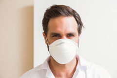 Carpenter wearing protective mask looking at camera Stock Image