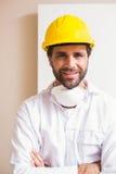 Carpenter wearing protective mask smiling at camera Stock Photos