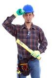 Carpenter Wearing Toolbelt Hardhat. On the white background.  Isolated on White Royalty Free Stock Images
