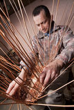 Carpenter weaves rattan Royalty Free Stock Photo