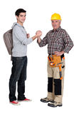 Carpenter welcoming his trainee Royalty Free Stock Photography