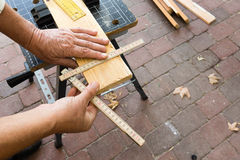 Carpenter who have lost one finger tip is measuring. Sept 22, 2016, Frederikssund, Denmark, Carpenter with a folding rule Royalty Free Stock Image