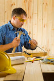 Carpenter wih chisel. Indoor shot Royalty Free Stock Photo