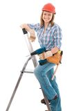 Carpenter woman. Cute carpenter woman holding a drill, wearing a hardhat Royalty Free Stock Photo