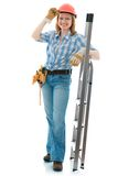 Carpenter woman. Cute carpenter woman with a stepladder, wearing a hardhat Royalty Free Stock Photos