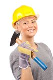 Carpenter woman with hammer Royalty Free Stock Photo