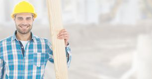 Carpenter with wood on building site Stock Images