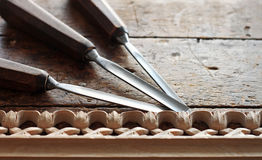 Carpenter wood chisel tool with carving Stock Photos