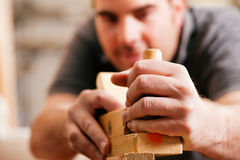 Carpenter with wood planer Royalty Free Stock Photo