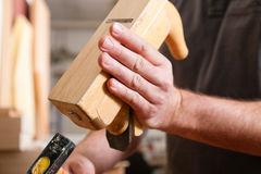 Carpenter with wood planer and hammer Royalty Free Stock Image
