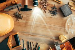 Carpenter woodwork workshop desk top view copy space. Carpenter woodwork workshop desk top view mock up with various tools around blank copy space of pine wood stock photos