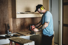 Carpenter woodworker working for house renovation Royalty Free Stock Photography