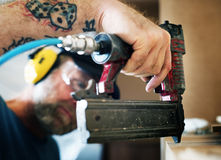Carpenter woodworker working for house renovation Stock Photo
