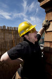 Carpenter at work. In pain over blue sky Royalty Free Stock Photos