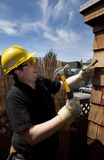 Carpenter at work. In pain over blue sky Stock Images