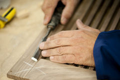 Carpenter At Work. Close-up of carpenter's hands using chisel Royalty Free Stock Images