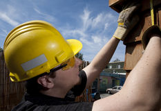 Carpenter at work. Over blue sky day time Royalty Free Stock Image