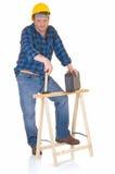 Carpenter at work. White background, reflective surface, studio shot Stock Photo
