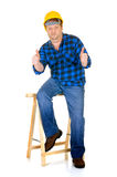 Carpenter at work. Carpenter with thumbs-up, white background, reflective surface, studio shot Stock Image
