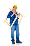 Carpenter at work. White background, reflective surface, studio shot Royalty Free Stock Photography