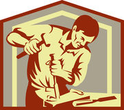 Carpenter at work chiseling Stock Photography