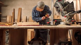 Experienced carpenter work with wooden stock photos