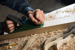 Carpenter at work Stock Images