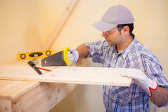 Carpenter at work cutting wood Royalty Free Stock Photos