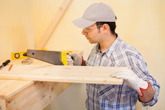 Carpenter at work cutting wood Royalty Free Stock Images