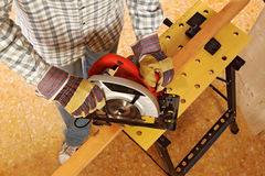 Carpenter at work detail. Closeup image of manual worker and classic grinder Royalty Free Stock Photos