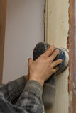 Carpenter at work with electrical sander Royalty Free Stock Photography