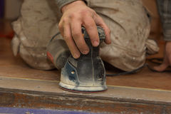 Carpenter at work with electrical sander Royalty Free Stock Images
