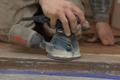 Carpenter at work with electrical sander Stock Photos