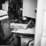 Carpenter at work in his atelier. Works wood by creating objects Stock Image