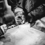 Carpenter at work in his atelier. Works wood by creating objects Stock Photo