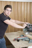 Carpenter at work on job using power tool. A Carpenter at work on job using power tool Royalty Free Stock Photos