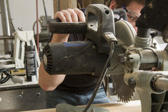 Carpenter at work on job using power tool Royalty Free Stock Photography