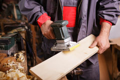 Carpenter at work with the sander Royalty Free Stock Photo