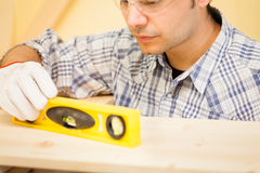 Carpenter at work using a bubble level Stock Photography