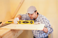 Carpenter at work using a bubble level Stock Images