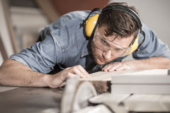 Carpenter at work with wood Royalty Free Stock Images