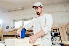Carpenter at work Stock Images