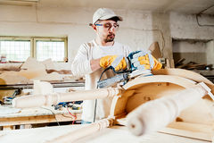 Carpenter at work. Carpenter working at a wood table Royalty Free Stock Photo